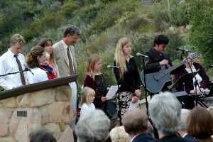 This was 2003, at Grandpa's memorial at the outdoor chapel overlooking the Thacher track. My daughter, the little girl in the center, is 5, my son (in my arms) is 2, and we're with siblings, nieces, and nephews. I often run and ride the trail on that hillside.