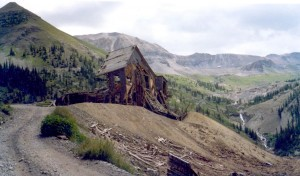 A snapshot from my parents' album showing Tomboy Mines in the 1970s, with the 13,114-foot Imogene Pass summit in the background.